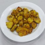 Baked Chili and Turmeric Potatoes