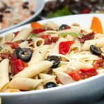 Kid Friendly Pasta Salad with colorfull vegetables and cheddar cheese